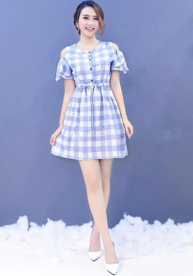 Nên chọn chiếc váy dài ngang gối cho người thấp và chân to nhằm ăn gian chiều cao của bạn